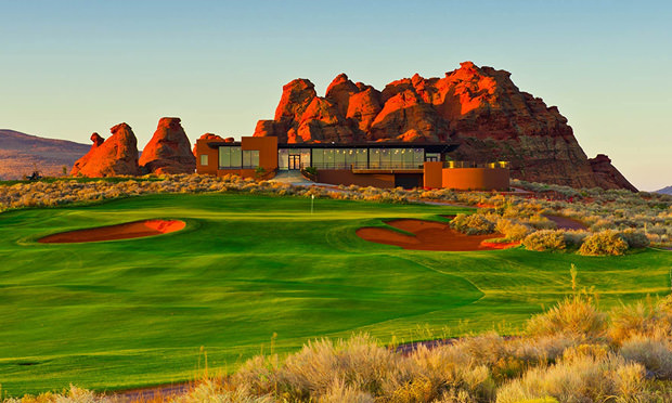 Fairway and green with a beautiful red rock backdrop at Sand Hollow Golf Course in St. George, Utah