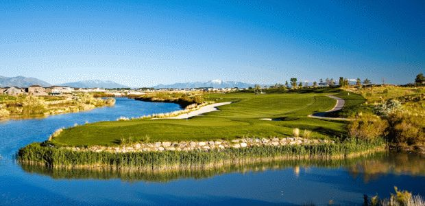 Beautiful shot of a Par-3 over the Jordan River at Thanksgiving Point Golf Course in Lehi, Utah