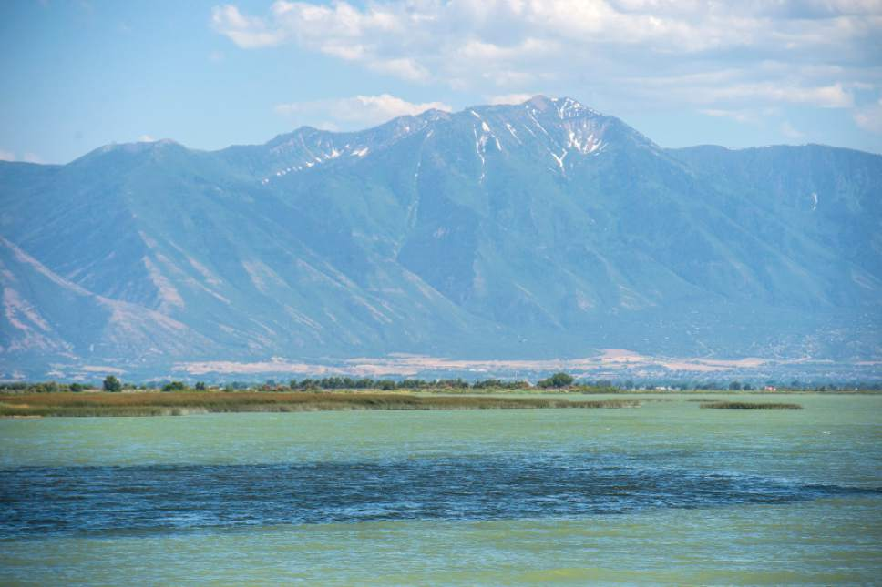 Utah Lake's waters vary from a turquoise - green to a deep blue depending where you are on the lake