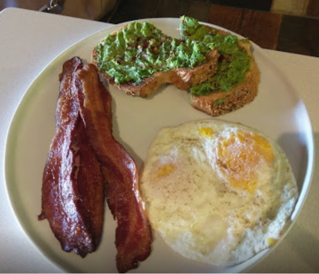 Cubby's Avocado Toast for breakfast with eggs and bacon