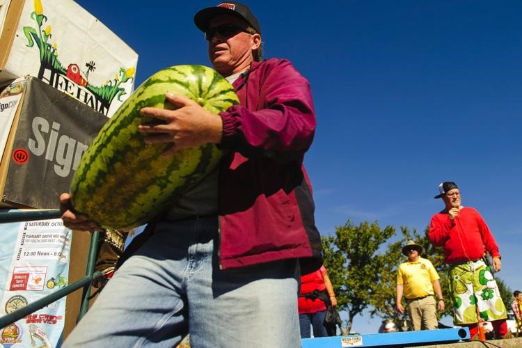 Man carrying large watermelon at the Thanksgiving Point Harvest Festival