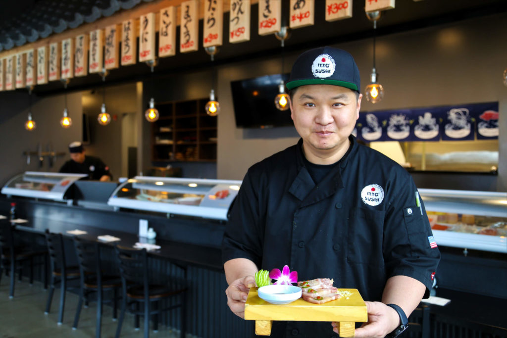 Chef Itto at Itto Sushi featuring a sashimi platter