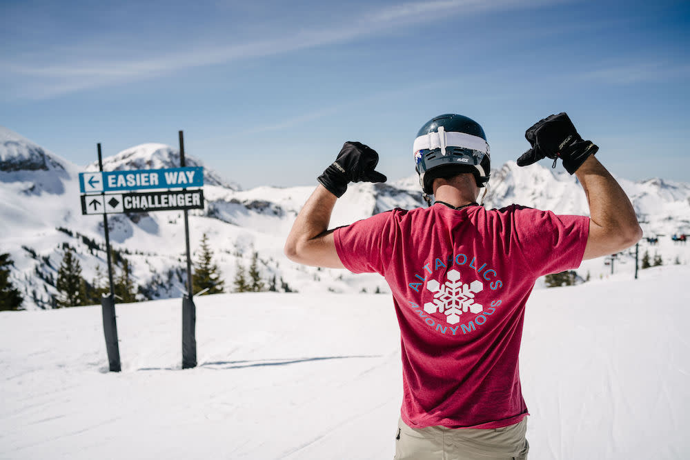 The slopes at Alta Ski Resort, featuring a skier with a great Altaholics Anonymous shirt